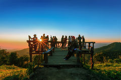 Unidentified tourists are enjoying at old wooden viewpoint. Royalty Free Stock Photo