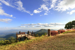 Unidentified  tourists are enjoying at old wooden viewpoint on to Royalty Free Stock Photo