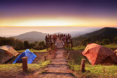 Unidentified tourists  are enjoying at old wooden viewpoint on to Royalty Free Stock Images