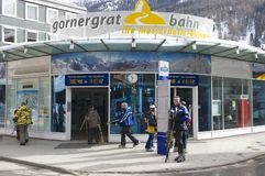 Unidentified tourists enter Gornergratbahn train station in Zermatt, Switzerland. Royalty Free Stock Photography