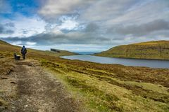 Unidentified tourists hikes in Sorvagsvatn lake over, Faroe Islands