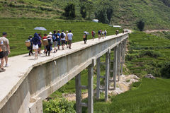 Unidentified tourists and locals cross concrete bridge Royalty Free Stock Photos