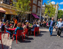 Unidentified tourists and locals at South Kensington area at summer day near  Casa Brindisa restaurant Stock Photography