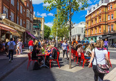 Unidentified tourists and locals at South Kensington area at summer day near  Casa Brindisa restaurant Stock Images