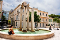 Unidentified tourists near fountain in Nimes, France Stock Image