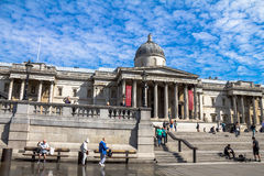 Unidentified  tourists near  National Gallery in Trafalgar Square, London . UK Stock Photo