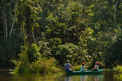 Unidentified tourists paddling a canoe in the Royalty Free Stock Image