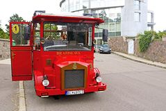 Unidentified  tourists in red vintage bus on the streets of Bratislava city