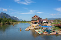 Unidentified tourists are rowing kayak boats in Nam Song River in Vang Vieng, Laos. Vang Vieng, Laos - January 19, 2017: Unidentified tourists are rowing kayak Stock Images