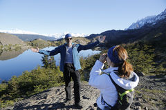 Unidentified tourists taken pictures in National Park Torres del Paine, Patagonia Stock Photo