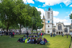 Unidentified tourists  tourists resting on the grass near Westminster Abbey Royalty Free Stock Photos