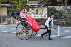 Unidentified tourists visit Arashiyama. KYOTO, JAPAN - MARCH 24, 2016 : Unidentified tourists visit Arashiyama and take rickshaw for sightseeing near Toketsukyo Royalty Free Stock Images