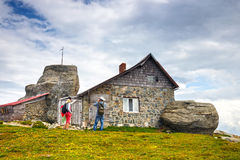 Unidentified tourists visit mountain shelter in Bucegi Mountains in Romania Royalty Free Stock Photos