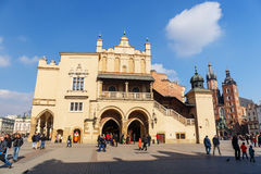 Unidentified tourists visiting main market square in Krakow, Poland Stock Image