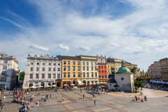 Unidentified tourists visiting main market square in Krakow, Poland Royalty Free Stock Photo