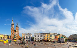 Unidentified tourists visiting main market square in Krakow, Poland Royalty Free Stock Images