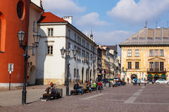 Unidentified tourists visiting small market square in Krakow, Poland Stock Photography