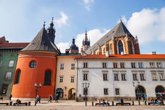Unidentified tourists visiting small market square in Krakow, Poland Stock Images