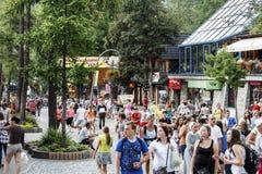 Unidentified tourists visits at the Krupowki street Stock Photo