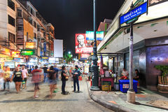 Unidentified tourists walking along Khao San Road at night, the most famous street in Bangkok Stock Photo