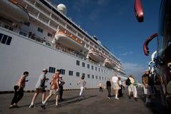 Unidentified tourists walking besides luxury Stock Image
