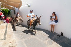 Unidentified tourists walking in historic town Lindos Stock Image