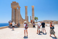 Unidentified tourists walking in historic town Lindos Stock Images