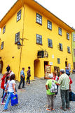 Unidentified tourists walking in historic town Sighisoara on July 17, 2014. Royalty Free Stock Images