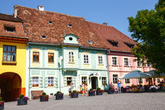 Unidentified tourists walking in historic town Sighisoara on July 08, 2015. Royalty Free Stock Photo