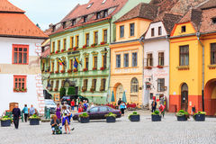 Unidentified tourists walking in historic town Sighisoara Stock Photography