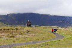 Unidentified tourists walking near Statue of Bardur Snaefellsnes Royalty Free Stock Photo