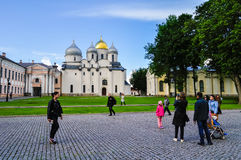 Unidentified tourists walking and taking the shots near St Sophia cathedral in Veliky Novgorod, Russia stock photography