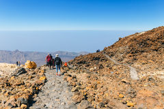 Unidentified tourists are walking on the top of El Teide Volcano, Tenerife, Spain Stock Images