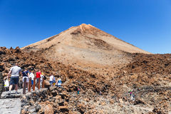 Unidentified tourists are walking on the top of El Teide Volcano, Tenerife, Spain Royalty Free Stock Photo