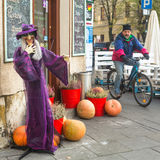 Unidentified townspeople and scenery for celebrating Halloween in Krakow. Royalty Free Stock Images