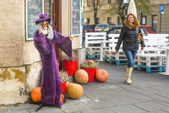 Unidentified townspeople and scenery for celebrating Halloween in Krakow. Royalty Free Stock Photo