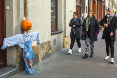 Unidentified townspeople and scenery for celebrating Halloween in Krakow. Royalty Free Stock Image