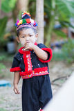 Unidentified traditionally dressed Hmong hill tribe child Stock Photo