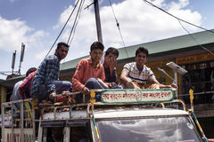 Unidentified travellers on a truck at Shima district. Transport for workers is often overcrowded. Stock Photos