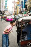 Unidentified tuk tuk  driver and tourists. BANGKOK, THAILAND - February 2, 2017: Unidentified tuk tuk  driver and tourists, they are talking something near Stock Images