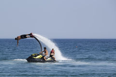 Unidentified Turkish man demonstrates flyboard acrobatics on the Royalty Free Stock Photo
