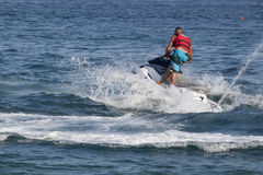 Unidentified Turkish man glides over the waves of the Mediterran Stock Photography