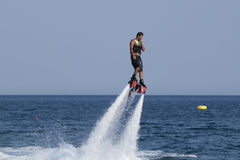 Unidentified Turkish man hovered above the water. Royalty Free Stock Photo