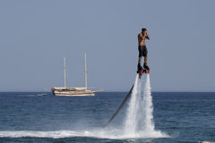 Unidentified Turkish man hovered above the water Stock Photography
