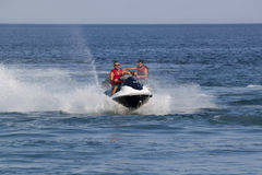 Unidentified Turkish men compete with each other on water scoote Royalty Free Stock Images