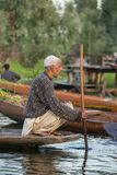 Unidentified vegetable sellers taking their produce to the floating market early in the morning on Dal Lake in Srinagar, Kashmir stock photography