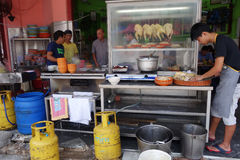 Unidentified vendor prepares steam chicken on his stall Stock Images