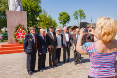 Unidentified veterans posing at camera during the celebration of Stock Photos
