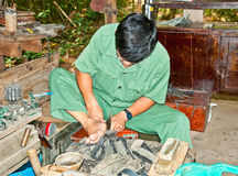 Unidentified vietnamese makes shoes from old truck tires in Cu C Stock Photo