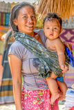 Unidentified villager with her son while selling their handcrafts to the visitors. LOMBOK, INDONESIA - FEBRUARY 23, 2016: Unidentified villager with her son Stock Photos